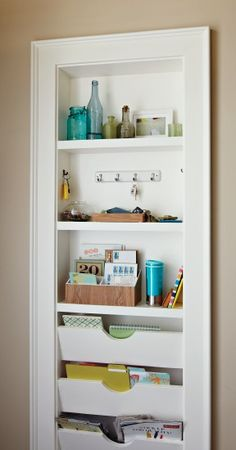 Shallow built-in recessed between wall studs for shelves, keys, etc.