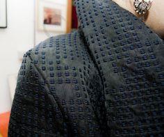 Un particolare del cappotto di Due Mosche Bianche
