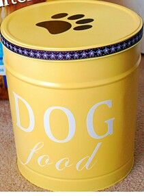 Upcycled Popcorn tin to dog food storage. Maybe attach a drawer pull on top for easy access?