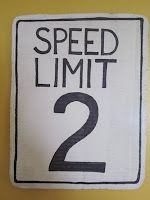 """Signs for the party: """"Caution: 2 Year Old Ahead!"""", """"Speed Limit 2"""", """"Party Zone"""""""