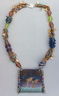 Here's the overall view of the dolphin amulet bag I designed. I incorporated 4 of my beaded beads into the neck strap.