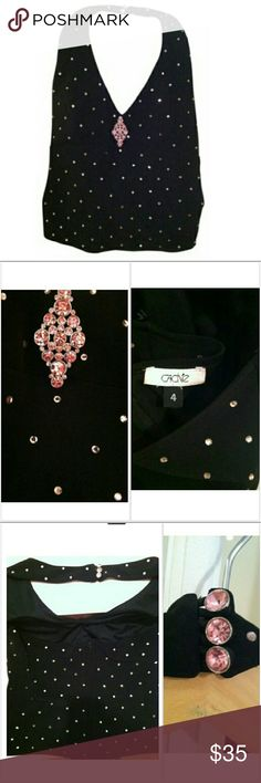 CACHE halter black with pink rhinestones size 4 CACHE halter black with pink rhinestones size 4 pictures don't show how gorgeous this top is The rhinestones cover this top and sparkle beautifully 3  rhinestone button closure back of neck and gorgeous pink rhinestone brooch on front SEXY and flattering well made, great price ! 97%polyester 3%spandex Cache Tops