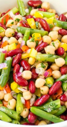 Fresh and Easy Three Bean Salad ~ Packed with goodness and a lightened up apple cider dressing that's sweetened with maple syrup...  It's the perfect side for picnics and barbecues!