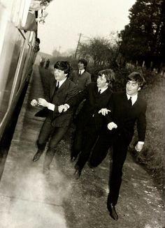 George Harrison, Paul McCartney, Richard Starkey, and John Lennon (boots on the run)