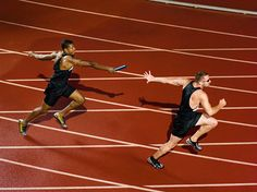 teammates-passing-the-relay-baton-picture-id78780561 (479×359)
