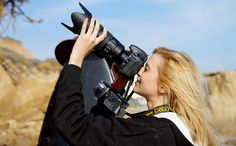 Photos of the Nikon D800 in the field, shot with the Sony A77 alpha mount SLT.  Swimsuit model holding the Nikon D800 with a Nikon 70-200mm f/2.8G ED VR II AF-S Nikkor Zoom Lens.    Fitted with the Nikon Nikon 70-200mm f/2.8 ED VR II AF-S Nikkor Zoom Le       Photos like this are needed all the time online. Find out from http://www.cameras-earn-money.com