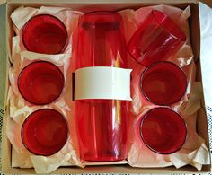 Boxed Cocktail Shaker Set. Red plastic shaker and six tumblers. Hollywood byTamco.
