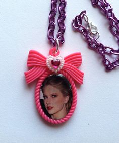 CUTE Taylor Swift Necklace on a pink bow cameo, purple aluminum chain, white heart with pink crystal. the best day, white horse, love story by AngelicConcepts, $14.00