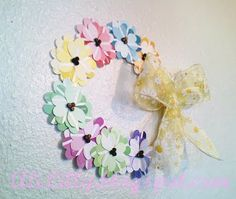 Cute flower idea even if you don't make the wreath, but it is a cute wreath also.  Would look cute on a child's door.