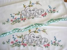 vintage embroidered squirrel pillowcases.
