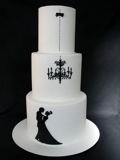 Black & white wedding cake with chandelier motif.