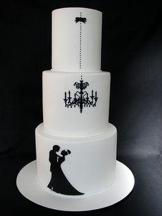 Black & white wedding cake with chandelier motif.