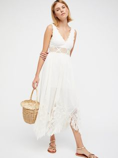 White Moon Diamond Maxi Dress | Lightweight cotton maxi dress featuring sheer crochet trim along the neckline, waist, and hem.    * Uneven hem with statement fringe trim   * Corset tie in back with tassel ends   * Lined
