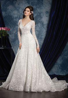 Romantic full length sleeves add romance and grandeur to this sophisticated wedding gown. The sheer back yoke is embroidered to match the shimmering accents across the A-line frame.