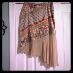 Tristan beautiful floral skirt Asymmetrical floral skirt from the brand Tristan. This is a very beautiful unique skirt made up of different fabrics and design. (66% polyester and 33%silk) Skirts Asymmetrical