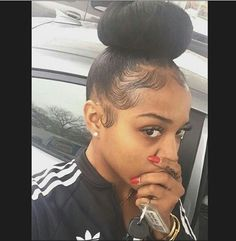 Baby hairs laid, bun on fleek. Achieve this look as simple as a bundle of Brazilian straight.