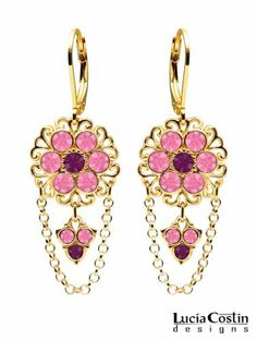 14K Yellow Gold Plated over .925 Sterling Silver Earrings by Lucia Costin Ornate with Violet, Pink Swarovski Crystals, Filigree Accents, Cute Charms and Falling Chains; Handmade in USA Lucia Costin. $69.00. Crafted with purple and rose Swarovski crystals. Lucia Costin flower shaped drop earrings. Mesmerizing enough to wear on special occasions, but durable enough to be worn daily. A perfect feminine touch. Unique jewelry handmade in USA