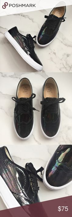 ✨HP✨ Banana Republic Krysta Brogue sneakers Banana Republic Krysta Brogue iridescent sneakers are NWOT and in excellent condition. Shoes are black in color with an iridescent shine. The perfect statement sneaker for any casual look! 🎉TOTAL TRENDSETTER PARTY HOST PICK 11.14.17🎉 Banana Republic Shoes Sneakers