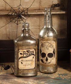 Mercury Glass Halloween Bottles $59.95 www.theholidaybarn.com This would be so easy to make....