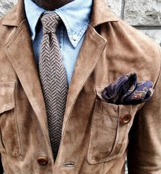 """Great casual look. The pocket square might be a tad too far - at least that """"puffy"""" - but the safari jacket and tie combo are great."""