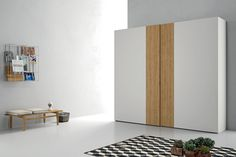 Modern Italian double door closet system, wood veneer / lacquer finish.