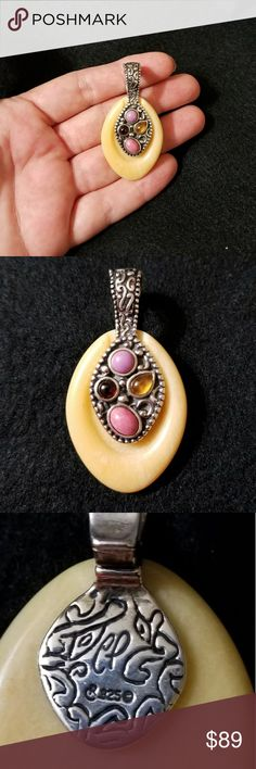 Carolyn Pollack Multi Gemstone Pendant •925 Sterling Silver - Stamped  •Carolyn Pollack - Stamped •Bale is embellished with 4 types of Gemstones  •The focal stone (is) carved yellow jasper •Measures: 54mm (2.13 inches) Length  & 28mm (1 1/8th inches) Width Carolyn Pollack Jewelry Necklaces