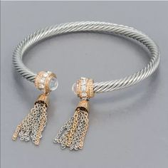 """Silver/Gold Tassel Open Cuff Bracelet GORGEOUS Silver & Gold Alloy Tassel Braided Cuff Bracelet with Clear stones, & Crystals. This piece is amazing! Approx. 2.5"""" Diameter Open to Fit Most Size Wrists, A Must have for your jewelry collectionPRICE IS FIRM UNLESS BUNDLED Boutique Jewelry Bracelets"""