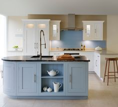 Shaker kitchen painted in Dulux 'Chiffon White 4' and 'French Grey' from the Heritage range, with curved cupboard and Pantry Larder.  #kitchens #paintedkitchens #madeintheuk