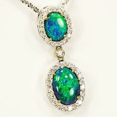 This beautiful black opal necklace will keep you thinking about the ocean all winter long. #opal #green #blue #stunning #necklace #diamonds #beautiful #jewelry #needit #wantit #doylestown #buckingham #bucks #buckscounty
