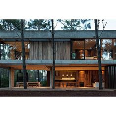 Design firm @atvarquitectos crafts a two-story cabin out of concrete and timber in the woodlands of Pinamar Buenos Aires Province Argentina. Photo: @flaneur_ag by hypebeast