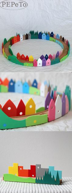 mommo design: IKEA HACKS - Rainbow railroad -- Use craft foam to make houses/landscapes and glue it to the wooden track.