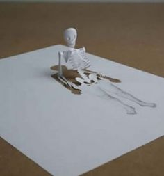 Kirigami paper art-  I like how this sculpture is 3d and 2d at the same time.  It remains a mystery whether the only material used was that actual sheet of paper or if they had to use extra paper.  The sculpture itself looks kind of like a dead body coming out  of its grave which is cool.