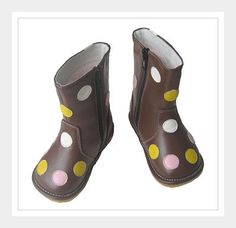 HANNAH - The water resistant Hannah boot is brown with multicolored dots all over. The inside is warm and fuzzy and the outside is to die for. This boot includes a zipper closure for easy put on and take off.