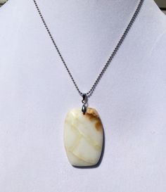 A personal favorite from my Etsy shop https://www.etsy.com/listing/233786804/white-jade-gemstone-pendant-necklace