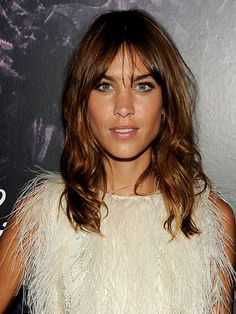"""BANGS If you're growing out thick, heavy bangs (what up, Zooey Deschanel?), let them grow to your brows before pushing them to one side. """"Once they get to eye length, let them separate in the middle and do that beautiful Gisele bang,"""" says Roszak. (Alexa Chung is a noted master of this look, too.) """"Have your hairstylist take the weight out of them so the ends aren't superthick and heavy,"""" she adds."""
