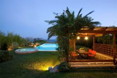 The private #garden is grass lawn, has many flowers, bushes and trees; and a beautiful #pergola right next to the swimming pool. #holidays #travel #vacationrental