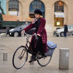 Catherine Baba travels by bike to the couture shows in Paris. This lady has got style. We applaud her. Photo by @gastrochic on Instagram.