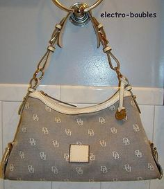SOLD!!!  AUTHENTIC Dooney & Bourke East / West Slouch Hobo in Gray / Cream Leather