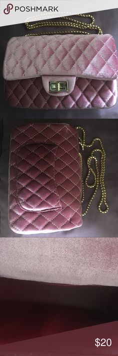 Velvet quilted style pink rose colored crossbody This is a very beautiful velvet pink rose, quilted style crossbody, or can be converted to a shoulder bag. It has a thick sturdy gold chain and a back pocket with a zippered pocket inside. It's in excellent condition, I only used it around 2 times, but it's to big for me.🌹🍭🙂 Bags Crossbody Bags