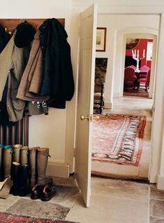 Love the coat rack, boots, rug and cream walls.