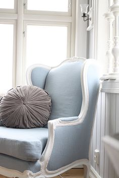 Blue and gray love this style of armchair and round cushion