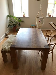 A beautiful Crate and Barrel dining table made of solid wood.