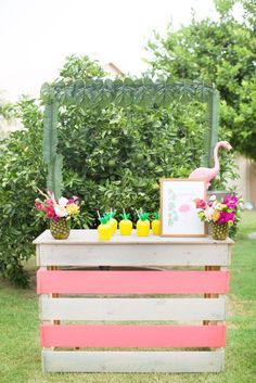 Flamingo Inspired Birthday Party: Adorable beverage station set up to look like a lemonade stand