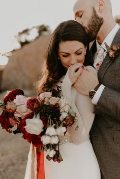 Click to browse the blog of this dream Wichita Mountains Bridals session • Peyton Rainey Photography   Posing inspiration for bride and groom, bridal fashion, bridal florals with red and pink tones