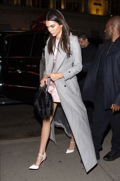 Kendall dons a blush pink mini dress and long grey coat to the Zoolander 2 Premiere in New York City.