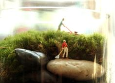 Above and beyond- Tiny World terrarium by Twig Terrariums. These are inhabited by tiny people in vignettes-- try using model-railroad sized characters (avail at your local hobby shop).