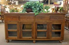 Very nice mango wood console or sideboard with 4 glass doors, 4 drawers.  Brand new on consignment from local furniture store. #OnTheShowroomFloor #Very #Nice #Mango #Wood #Console #Sideboard #Glass #NEW #Designer #StillGoode