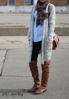 fleece leggings, boots, light blue shirt, sand over coat with short sleeves, maybe grey t-shirt