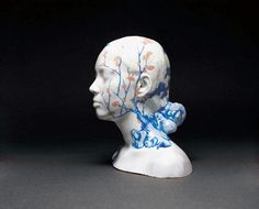 Porcelain Busts Imprinted with Chinese Decorative Designs by Ah Xian