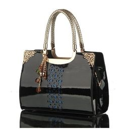 Patent leather handbag with gold detail and zipper closure